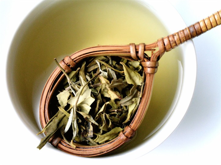 Benefits of Tea White Teas Brewed and Loose Leaf in Wooden Strainer