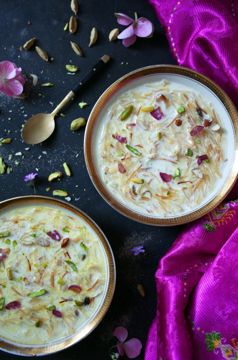 Two bowls of Seviyan Kheer topped with rose and pistachios