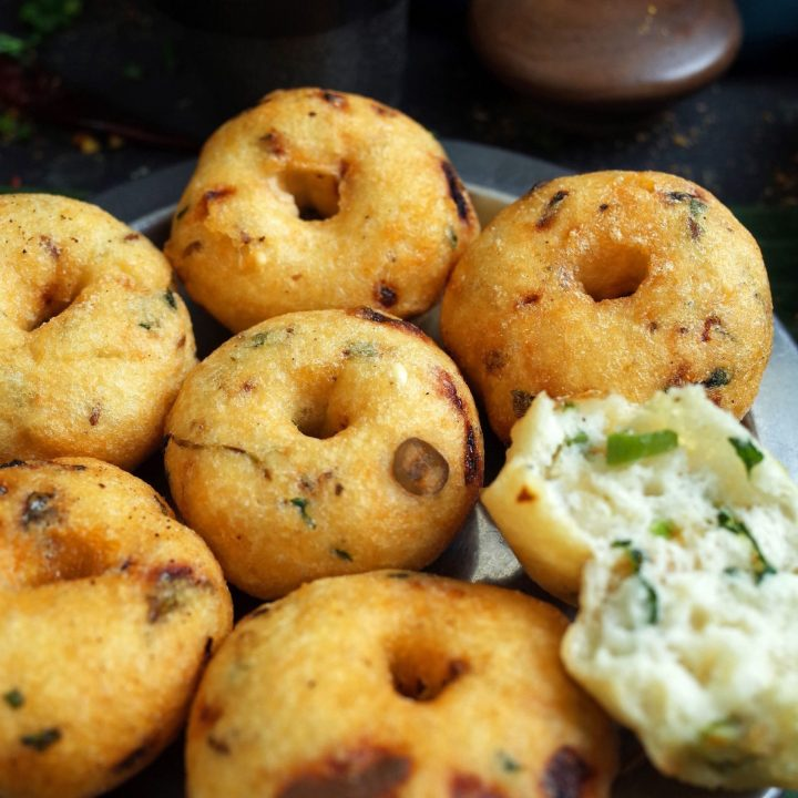 A stack of Medu Vada on a steel plate