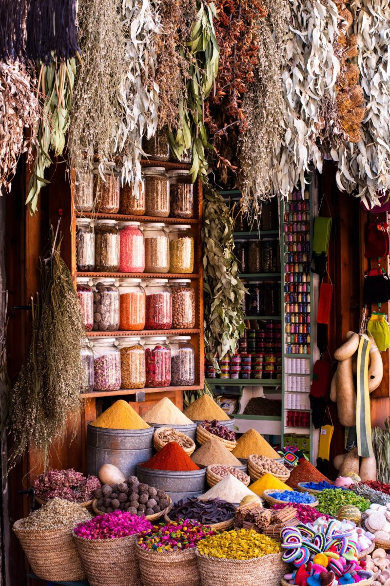 A spice market with various different spices in baskets and jars