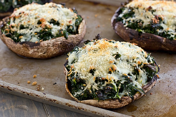 Kale Stuffed Portabella Mushrooms on a Baking Sheet
