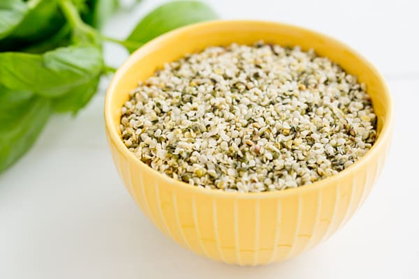 Hemp Seeds in yellow bowl on white background