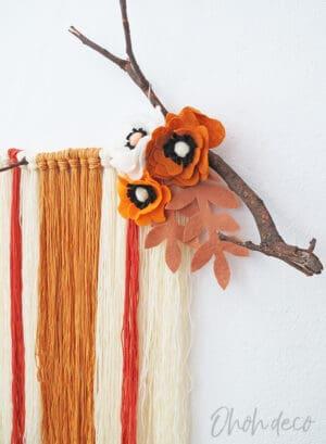 DIY yarn wall hanging with felt flowers