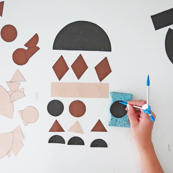 punch holes into paper shapes