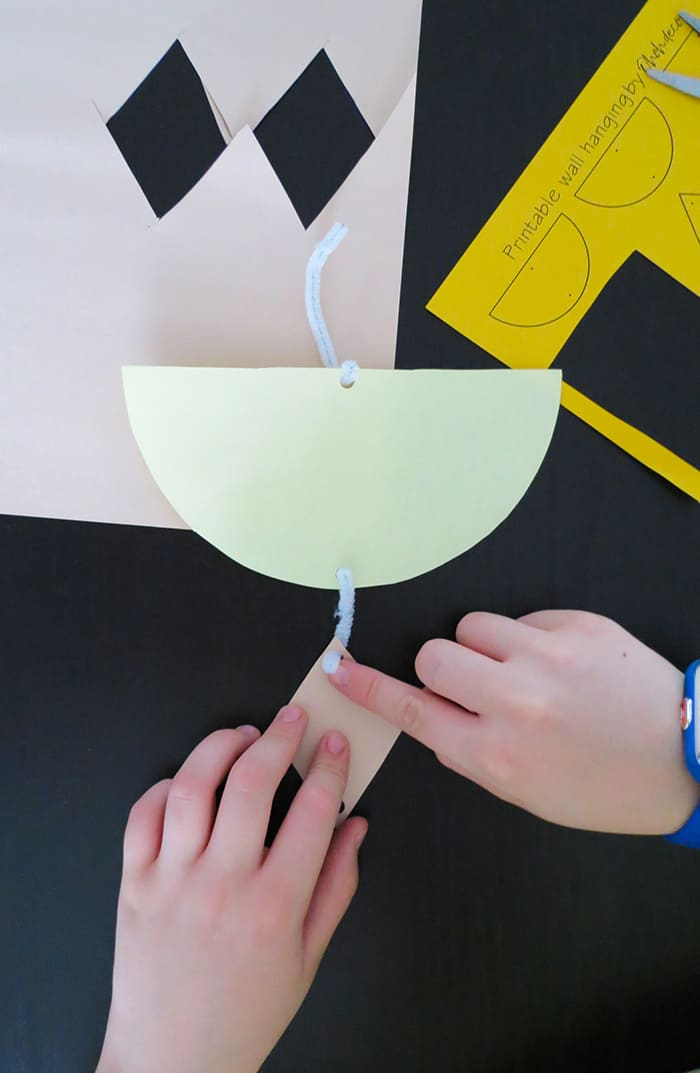 attach shape of kids paper wall hanging