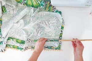 slide the dowel to make relaxed roman shades