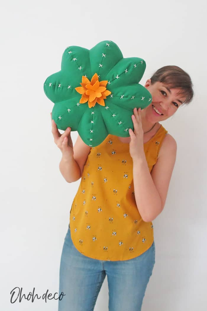 cactus shaped pillow and person