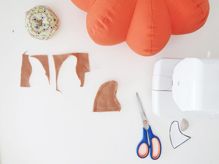 sew the stem for pumpkin shaped pillow