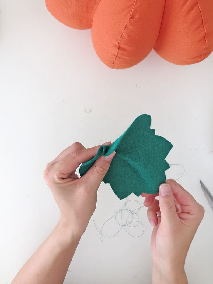 fold and sew the leaf on the pumpkin pillow