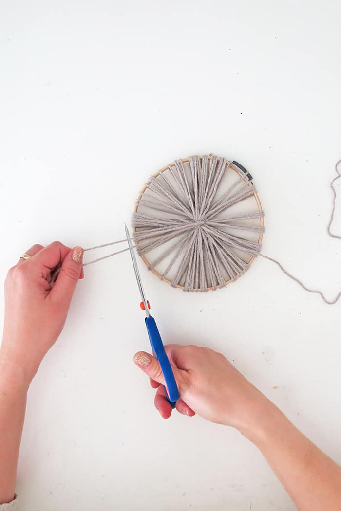 cut the yarn to make giant pom poms