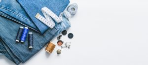 oh sew fearless - newsletter sign up.  A pair of jeans on a white background with sewing accessories