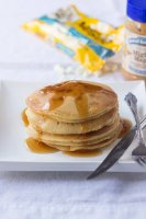 Mighty Maple Pancakes with white chocolate chips. A new favorite pancake recipe with @Peanutbutter&co ohsweetbasil.com