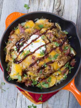 Tailgator Nachos loaded with BBQ Pork, roasted potatoes, Bacon and cheeeeeese!!! ohsweetbasil.com