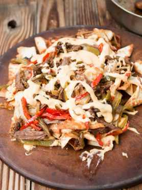 Philly cheese steak nachos!! These things are the winner of the nacho showdown! ohsweetbasil.com