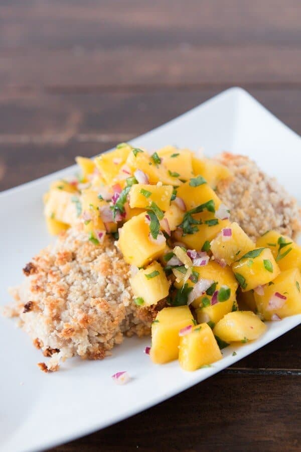 We may not being going to Hawaii this month but at least we can make this delicious macadamia crusted mahi mahi with mango salsa!