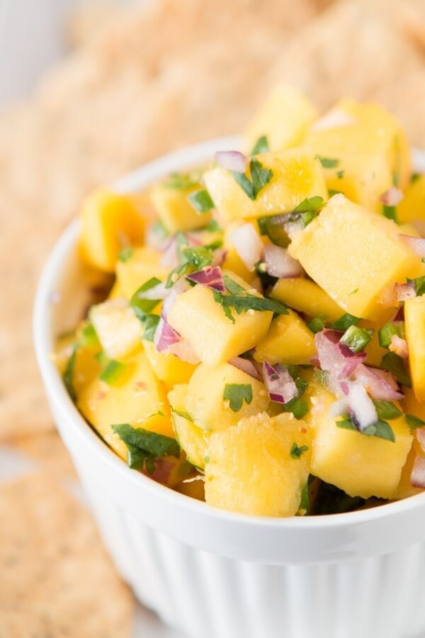 The Best mango salsa has a secret ingredient ohsweetbasil.com paleo, whole 30, gluten-free, dairy-free