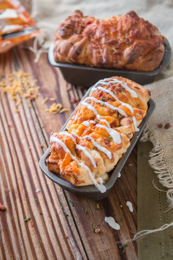 Party food, game day appetizers, or even just a need for carbs this Bacon Ranch Cheesy Pull Apart Bread is exactly the thing you've been craving. ohsweetbasil.com