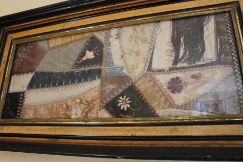 Framed remnant of a crazy quilt