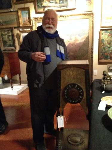 Scott Bishop, Owner of Westwood Antiques, admiring a Carlo Bugatti stand