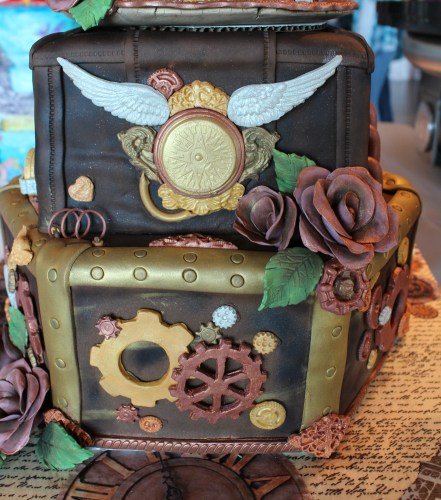 Stacey Kolopus's detail on her steam-punk themed cake merited 1st Place in the Beginner division of Fondant All-Occasion cakes.