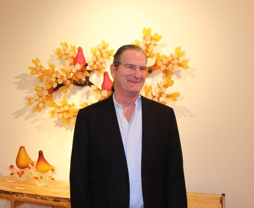 """Richard Jolley in front of """"Doves on Amber Branches"""""""