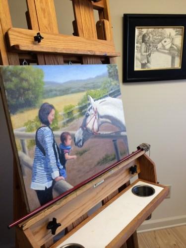 An easel holds art in progress in the studio of Diana Dee.