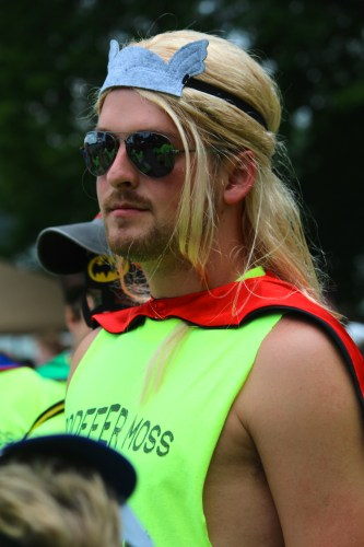 Team Rodefer wearing masks and capes at KARM Dragon Boat Festival