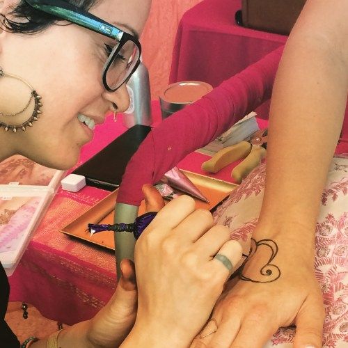 Tattooing done in a tent at Portland's Saturday Market!