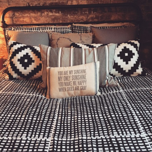Black and white decor in a loft bedroom in downtown Knoxville