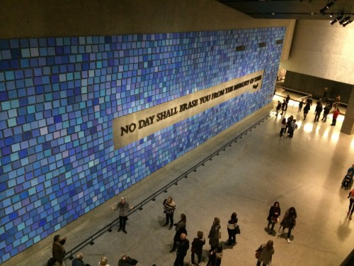 "Mosaic wall with quote: ""No day shall erase you from the memory of time."""