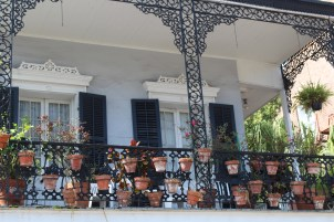 Small pots hang on the ironwork in the French Quarter