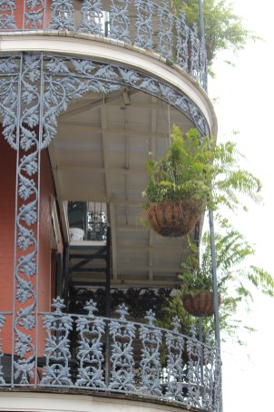 Baskets hang from ornamental ironwork in New Orleans' French Quarter.