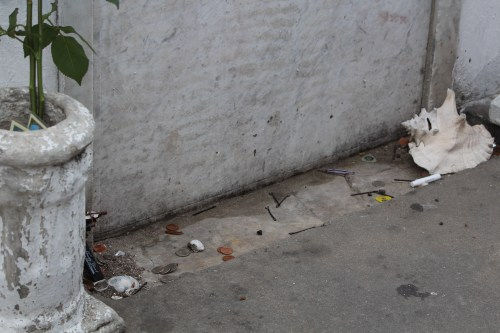 Trinkets laid at base of Marie Laveau's tomb, St. Louis Cemetery #1