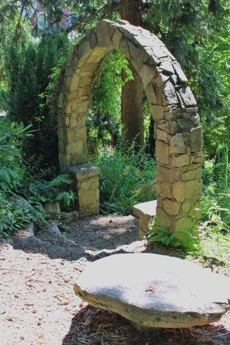 Stone archway at entrance to garden pathway -- Savage Gardens.