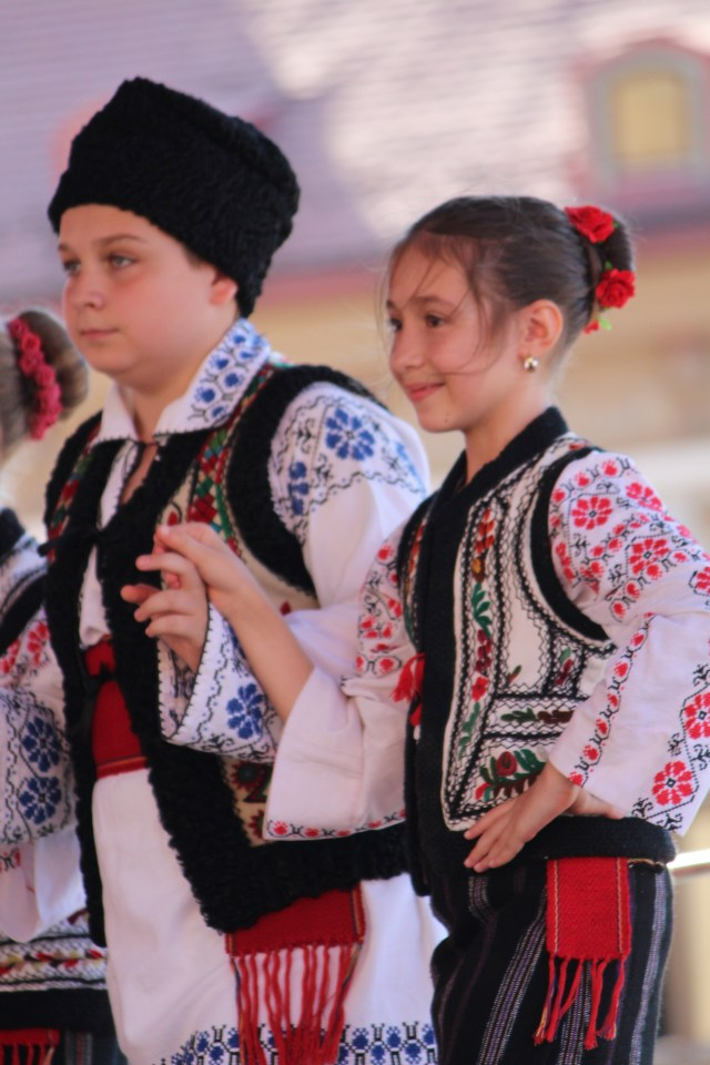 Two dancers join in as the team competes in Brasov, Romania.