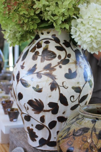Kline positioned this stunning vase in the middle of a long country table filled with pottery -- quite the centerpiece!
