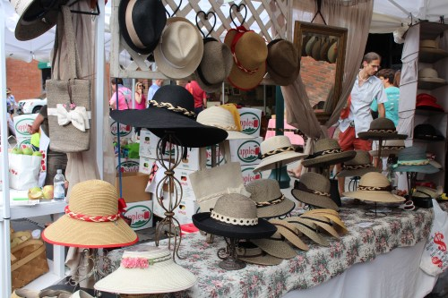 "Booth filled with great looking hats invited folks in to ""try one on""!"