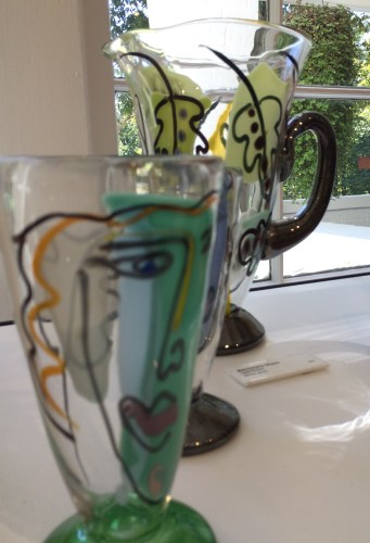 Bernstein Glass: face and leaf pitchers of blown glass