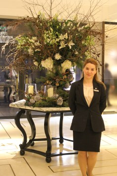 Standing in front of a beautifully designed natural arrangement, this lady helped us find our way through the Mayfair area.
