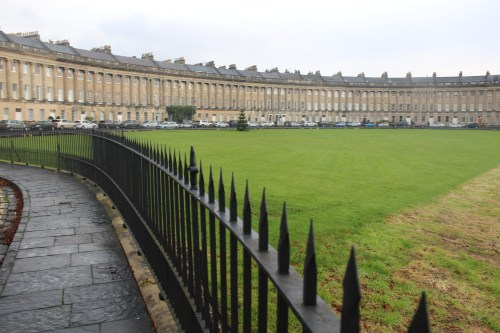 View of The Royal Crescent with a ha-ha in foreground.