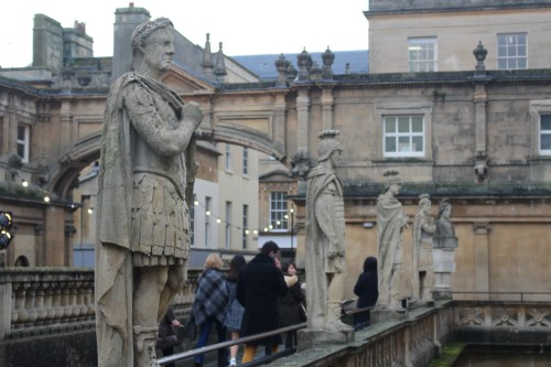 Visitors on the terrace of Roman Baths, Bath, England