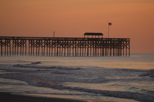 Pink light before dawn at Pawleys Pier