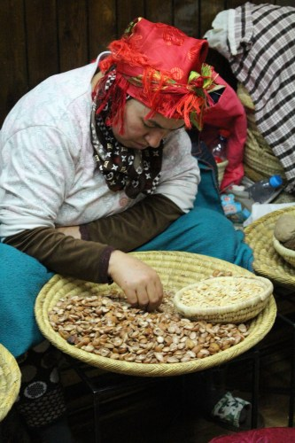 Shelling argan nuts in the Marrakech medina.