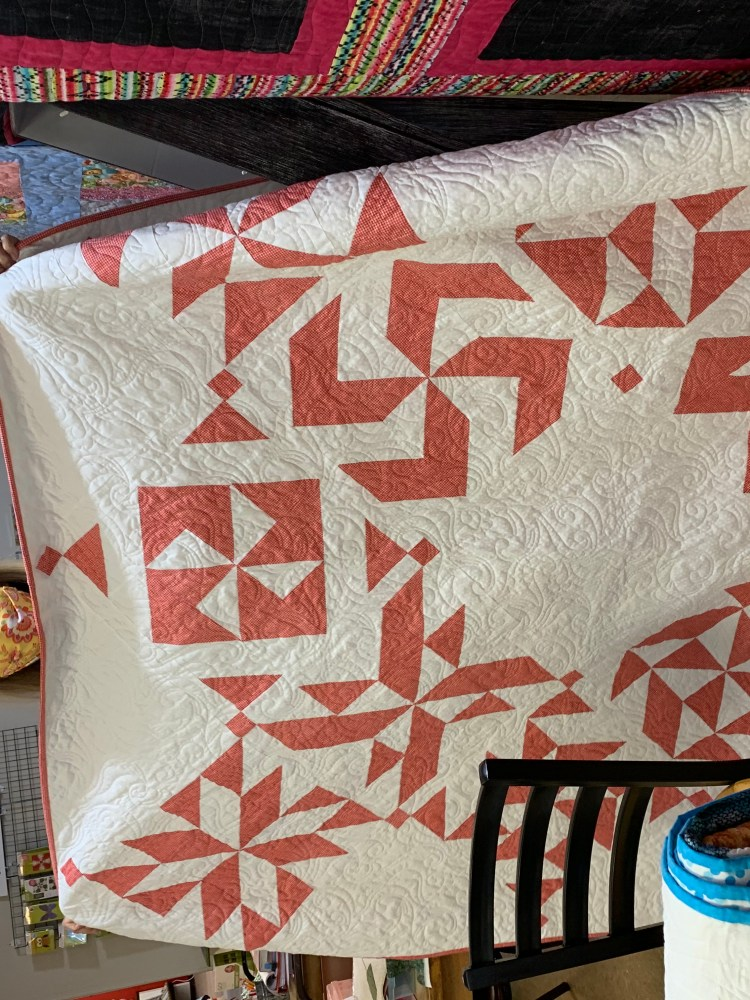 Lisa Lee shows off an award-winning quilt at Loose Threads
