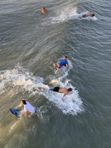 Surfing together: Pawleys Island SC