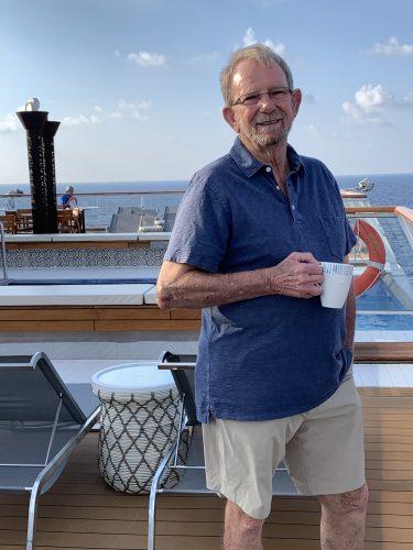 Bert drinking coffee on Viking ship deck