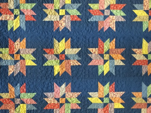Blue quilt with colorful stars
