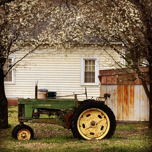 John Deere tractor and country house