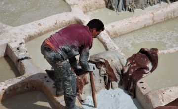 Fez tannery - man in boots