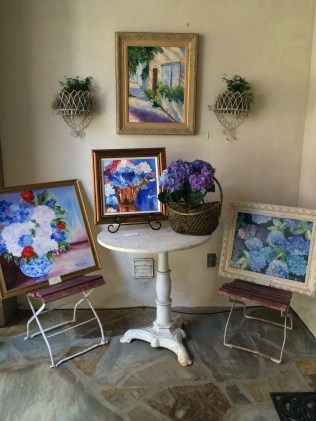Displayed on the back patio were paintings in soft colors by Melanie Wood.